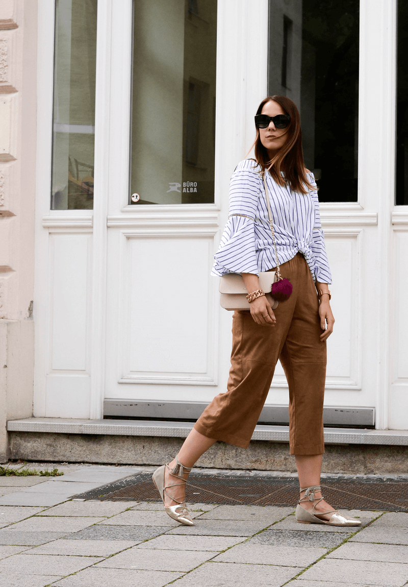 LEATHER CULOTTES, STATEMENT BLOUSE & METALLIC SANDALS